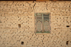 Detail of a romanian earh house. Traditional earh - mud brick contruction with a wooden window Stock Image