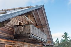 Detail of a rustic mountain hut made of wooden facade in the Alps stock photography