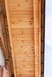 Detail of of roof structure with wooden rafters and insulation layer with tile. Detail of of roof structure with wooden rafters and insulation layer with tile stock photo
