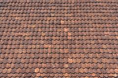 Detail of an old red brown tile roof. Detail of a roof surface made with old red brown roof tiles stock images