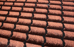 Detail roofing. Roofing shingle, a red background Royalty Free Stock Image