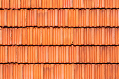 Detail of roofing tiles. Detail of many red roofing tiles on a house front Stock Images