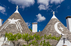 Detail of roofs and signs of the trulli houses, Alberobello town, Apulia region, Southern Italy Royalty Free Stock Photo
