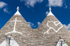 Detail of roofs and signs of the trulli houses, Alberobello town, Apulia region, Southern Italy Stock Photos