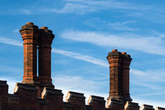 Detail of rooftop red brick chimneys in Tudor architecture Stock Photo