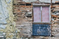 Detail of a rotten house. Old wooden window and detail of a dilapidated house Royalty Free Stock Photos