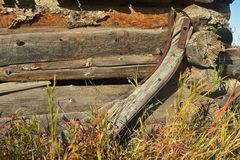 Detail of rotting log barn and wagon yoke Stock Photography