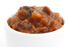 Detail of rough fruit chutney in white dish Royalty Free Stock Images