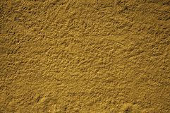 Rough plaster wall with small gravel inserted on it royalty free stock photography