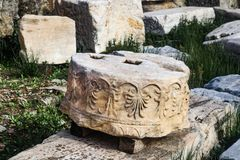 Detail of round broken section of column of Parthenon at Athens Acropolis that has been identified but not yet used in reconstruct royalty free stock image