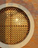 The detail of a round shaped window decorated with Chinese pattern brick Royalty Free Stock Images