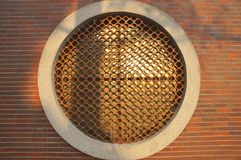 The detail of a round shaped window decorated with Chinese pattern brick Royalty Free Stock Photo