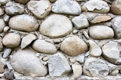 Detail of round stones and cement wall Stock Image