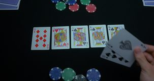 Detail of a royal flush on black background. Royal Flush of spade in poker game on a black background. Player collected stock footage