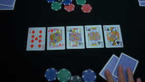 Detail of a royal flush on black background. Royal Flush of spade in poker game on a black background. Player collected Royalty Free Stock Photography