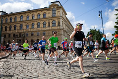 Detail of runners on 3rd km of PIM. Detail of runners on 3rd km of Prague International Marathon 2012 Stock Photo