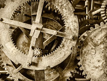 Detail of a rusty ancient church clock mechanism. Sepia toned detail of a rusty ancient church clock mechanism stock images