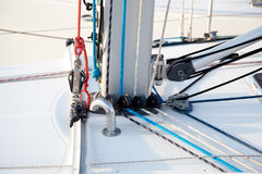 Detail of sailboat mast bottom with ropes Stock Photos