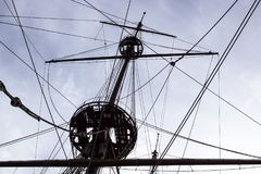 Detail of a sailboat rigging. Mast on traditional sailboats. Mast of large wooden ship. Royalty Free Stock Photo