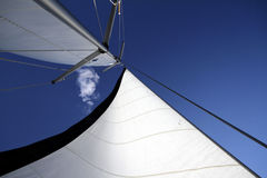 Detail of sails against blue sky Stock Photo