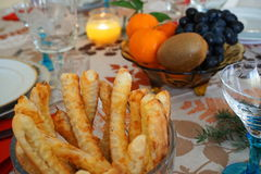 Detail of salted pastries-salées in a bowl, on a Christmas/New`s year festive table at candle light. Christmas/ New`s Year festive home table showing some royalty free stock photography