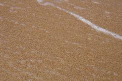 Background. Detail of brown sand and water sea. Background with brown sand and water sea Stock Image