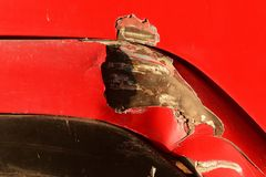Scratch on surface red door of truck. Detail scratch on surface red door of truck Royalty Free Stock Photo