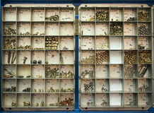Detail of the screws storing box. In a repair shop Royalty Free Stock Photo
