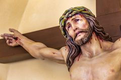 Crucifixion of Jesus Christ. Detail of sculpture of the Crucifixion of Jesus Christ with crown of thorns Stock Photos