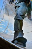 Detail of a sculpture , legs of a skateboarder Stock Photo
