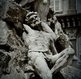 Detail of a sculpture of a man lying on his back. Part of a statue in Turin, Italy Stock Photos