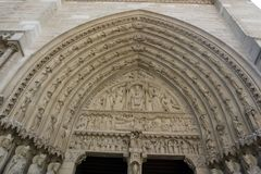 Detail of sculptures on Notre dame cathedral right entrance, Paris stock photos