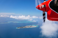 Detail of sea plane engine above Maldives islands Stock Photos