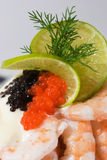Detail of seafood sandwich. With shrimps, roe of capelin, mayonnaise, lime and dill Stock Images