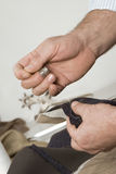 Detail of sewing hand Royalty Free Stock Images