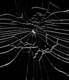 Detail of the shattered glass - cracks and shards. Hit glass stock photography
