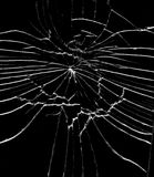 Detail of the shattered glass - cracks and shards. Hit glass royalty free stock photo