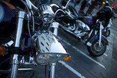 Detail of Shiny Chrome Headlight on Cruiser Style Motorcycle. Detail of a shiny chrome headlamp on a cruiser style motorcycle, seen at dusk in North Beach, San Stock Image