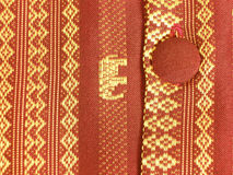 Detail of Shirt. Detail of a Oriental men's shirt including a front button with gold thread woven through the fabric Royalty Free Stock Photography