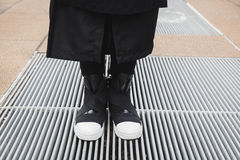 Detail of shoes of a man posing in the street Stock Image