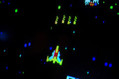Detail on a shooting space ship of an old arcade video game. Screen display Stock Image