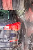 Car wash cleans dirty car stock image