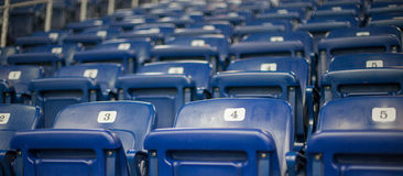 Detail shot of blue chairs in a stadium Royalty Free Stock Image