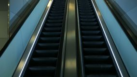 Detail shot of escalator in modern buildings or subway station. 4k stock video footage