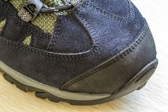 Detail shot of fragmrnt of new fashionable hiking mountain boot. Stock Photos
