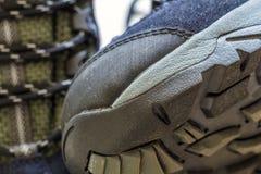 Detail shot of fragmrnt of new fashionable hiking mountain boot. Royalty Free Stock Photo