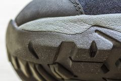 Detail shot of fragmrnt of new fashionable hiking mountain boot. Stock Photography