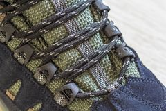 Detail shot of fragmrnt of new fashionable hiking mountain boot. Royalty Free Stock Photography