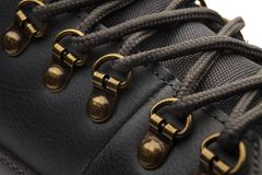 Detail shot of fragmrnt of new fashionable hiking mountain boot. stock photo