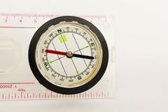 Detail shot of a glass compass isolated on white background Stock Photo